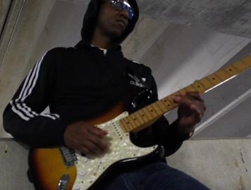 Urban Guitar Legend in Parking Deck